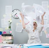 Angry Businesswoman Throwing Paperwork In Air