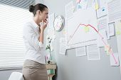 Businesswoman Analyzing A Financial Chart
