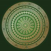 Golden ethnic round texture with shadow on dark green