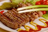image of scallion  - Grilled sausages with red hot chilli peppers - JPG