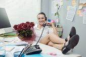 Office Worker Having A Romantic Call