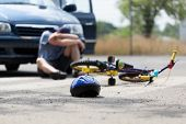 stock photo of accident victim  - A boy suffering after a bike accident with a car - JPG