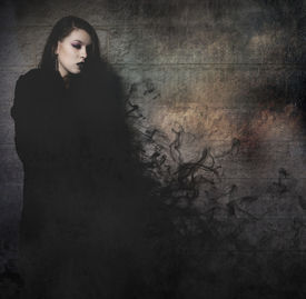 foto of gothic hair  - Gothic young with long black cape - JPG