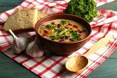 image of fresh slice bread  - Bean soup in bowl with fresh sliced bread on napkin - JPG