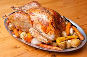 foto of turkey dinner  - roast turkey dinner with seasonal vegetables for a family holiday meal - JPG