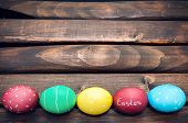 stock photo of easter basket  - Easter eggs lying in a basket - JPG
