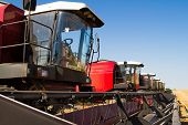 image of combine  - Combine harvesters in a wheat field ready for harvest - JPG