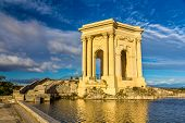 picture of aqueduct  - Water tower at the end of aqueduct in Montpellier France - JPG