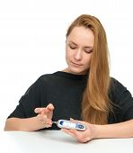 stock photo of diabetes  - Diabetes diabetic patient woman measuring glucose level blood test with glucometer before insulin injection on a white background - JPG