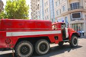 Firetruck In The City Rushing To The Fire poster