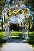 picture of wedding arch  - Beautiful wedding arch decorated with flowers in the forest resort - JPG