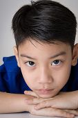 picture of sad boy  - portrait of asian cute boy sad and looking very disappointedon gray background - JPG