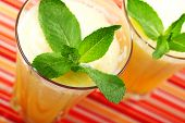 picture of mango  - Two glasses of Mango smoothies shot from above - JPG