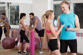 pic of flirt  - Two couples flirting during fitness classes - JPG