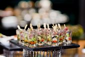 foto of buffet  - Closeup of sweet tasty dessert on modern table buffet - JPG