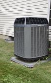 foto of air conditioner  - Residential outdoor air conditioner by a house with vinyl siding - JPG