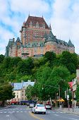 image of chateau  - Chateau Frontenac in the day with cloud and blue sky in Quebec City with street - JPG