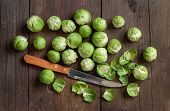 image of brussels sprouts  - Brussels sprouts with leaves and knife on wood - JPG