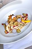foto of veal  - Noodles veal and vegetables on a plate - JPG