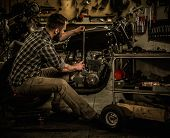 picture of carburetor  - Mechanic building vintage style cafe - JPG
