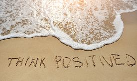 foto of think positive  - think positive written on the sand beach  - JPG