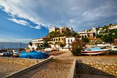 foto of hydra  - Dry river bed and boats in a fishing harbour in the town of Hydra - JPG