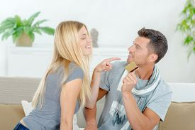 stock photo of possession  - Couple fighting over possession of credit card - JPG