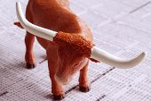 picture of nyse  - A bull on a financial newspaper representing strength in the economy - JPG