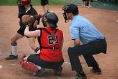 stock photo of umpire  - a catcher and umpire in position for the pitch in a fastball game - JPG