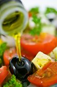 olive oil in salad closeup