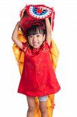 Постер, плакат: Smiling Asian Chinese Little Girl With Lion Dance Costume