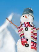 Happy snowman on mountain