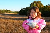 Little Girl Holding Conk Shell