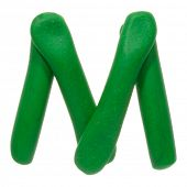 Colour plasticine letter isolated on a white background - green M