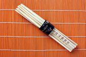 chopsticks on bamboo placemats