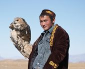 Eaglehunter with hunting owl
