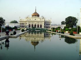 stock photo of muharram  - Imam Bargah Husainabad the famous chota imambada of lucknow with its reflection in the canal - JPG