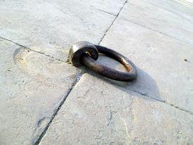 image of muharram  - Heavy iron ring embeded in the pavement flooring of historic chhota imaambada of Lucknow - JPG