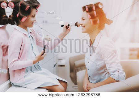 poster of Little Girl With Curlers. Beautiful Little Lady. Girl In Beauty Salon. Girl With Brush In Hands. Con