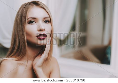 poster of Professional Makeup. Blond Girl In Beauty Salon. Makeup In Beauty Salon. Beautiful Woman. Blond Girl
