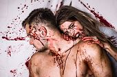 Halloween Zombie Couple Of Muscular Man And Bloody Young Woman With Wounds And Red Blood. Sexy Woman poster