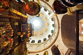 Dome and candles in the church of the Holy Sepulchre, Jerusalem, Israel