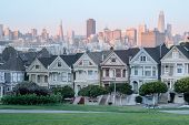 Sunset Over The Painted Ladies Of San Francisco. Iconic Victorian Houses And San Francisco Skyline I poster