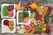 Diet health food concept with a large variety of vegetables, fruit, meat, fish, grain salad and spic poster