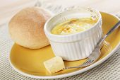 Breakfast with Swiss styled baked eggs in ramekin with the bun