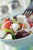 Greek salad with kalamata olives in the bowl closeup