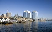 Tall ships docked in the early morning on Halifax's waterfront at Purdy's Wharf and farther down the