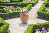 Large clay planters and clipped boxwood hedges are part of the formal gardens in the Bermuda Botanic