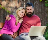 Couple In Love Notebook Consume Content. Couple With Laptop Sit Bench In Park Nature Background. Sur poster