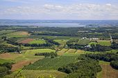 Aerial view of farmland with orchards along the coast of Nova Scotia, Canada.